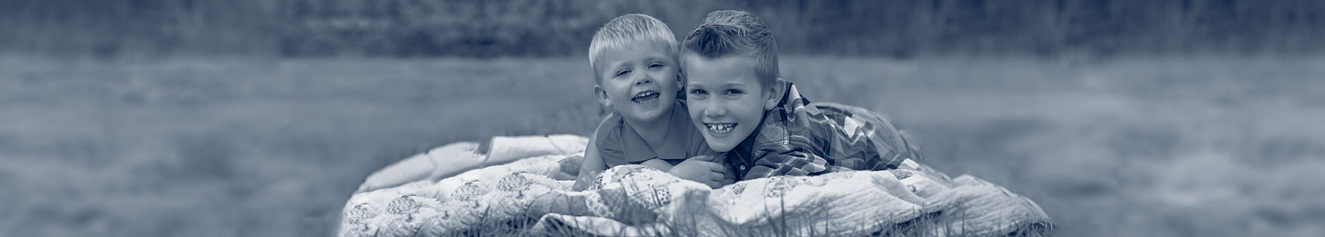 Two boys on blanket, colorized
