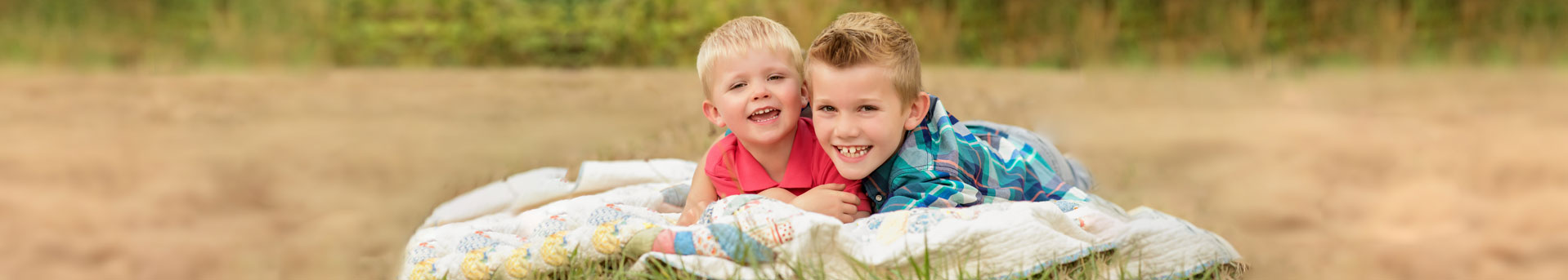 Two boys on blanket