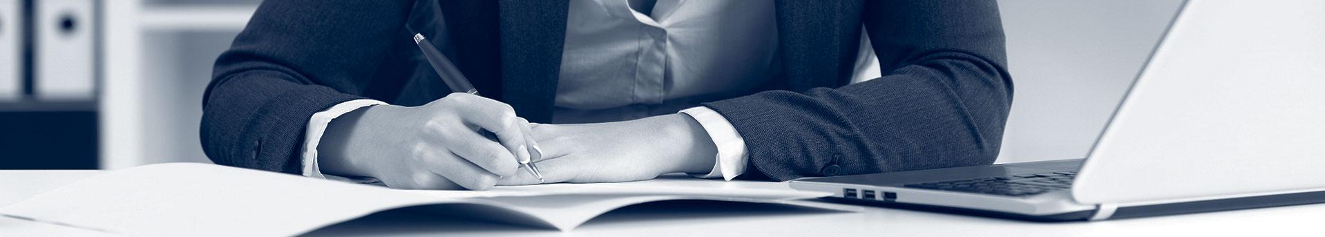 Woman doing paperwork, duotone